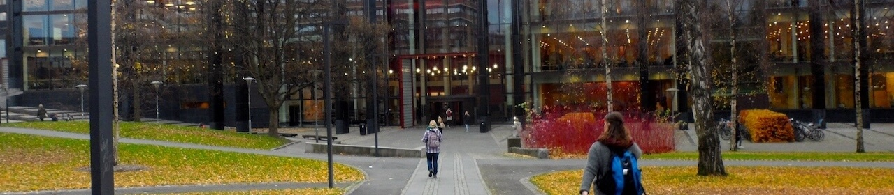 Student walking toward University of Oslo library